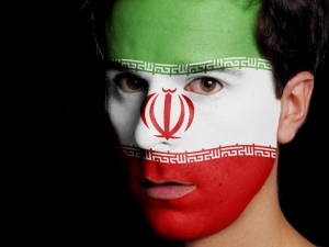 Flag of Iran Painted on a Face of a Young Man
