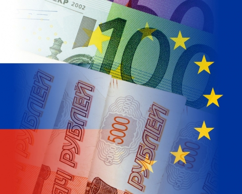 russia and eu flags with euro and ruble banknotes