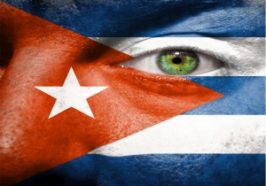 Flag painted on face with green eye to show cuba support